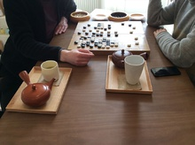 Enjoying tea and playing